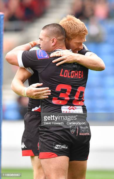 Salford Red Devils' Tui Lolohea is congratulated on scoring his first try as a Salford player SALFORD ENGLAND JULY 21 during the Betfred Super League...