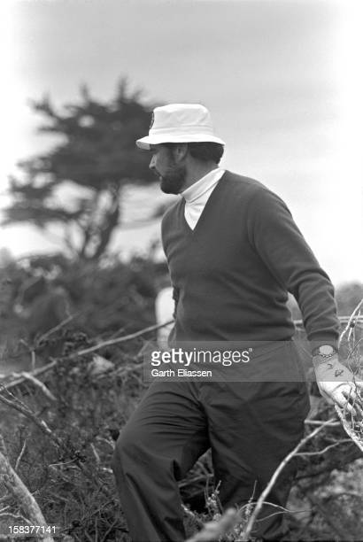 During the Bing Crosby National Pro-Amateur golf tournament, American actor James Garner looks for his ball in the rough on the course near the 17th...