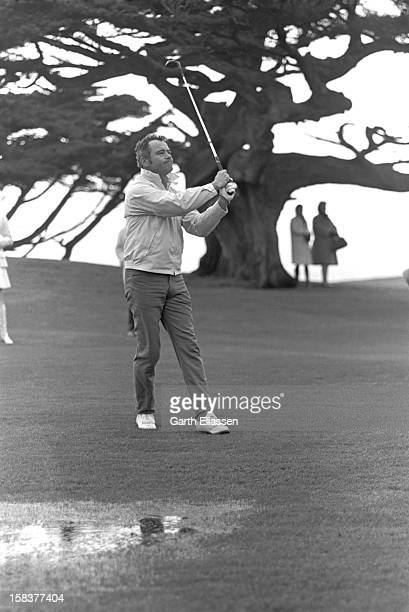 During the Bing Crosby National Pro-Amateur golf tournament, American actor Jack Lemmon watches his shot from the fairway on the course near the 18th...