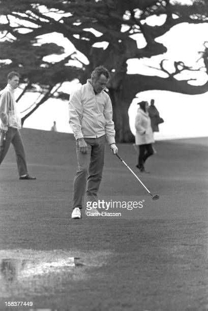 During the Bing Crosby National Pro-Amateur golf tournament, American actor Jack Lemmon reacts to his shot from the fairway on the course near the...