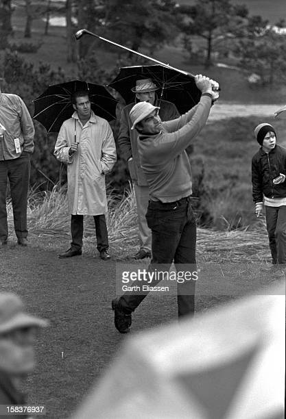 During the Bing Crosby National ProAmateur golf tournament Scottish actor Sean Connery tees off on the course at Cypress Point Pebble Beach Florida...