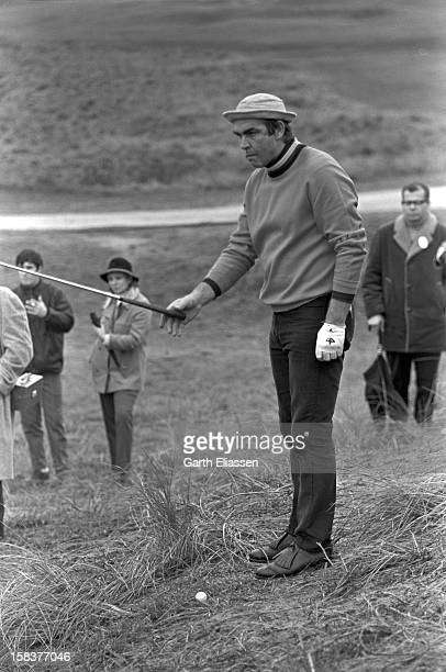 During the Bing Crosby National ProAmateur golf tournament Scottish actor Sean Connery grimly lines up a shot from the rough on the course at Cypress...