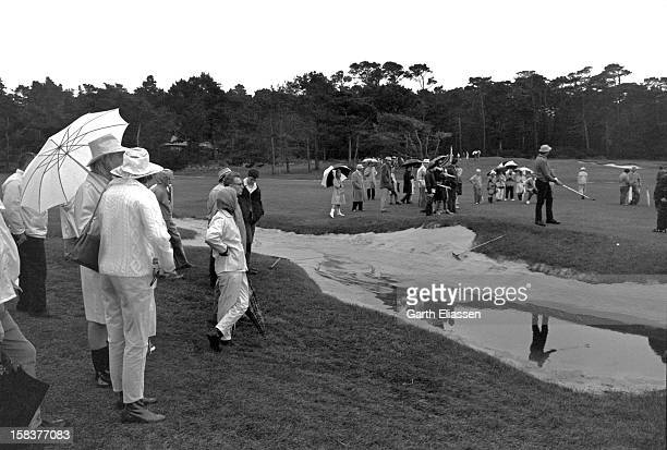 During the Bing Crosby National ProAmateur golf tournament spectators watch as Scottish actor Sean Connery prepares to shoot on the Cypress Point...