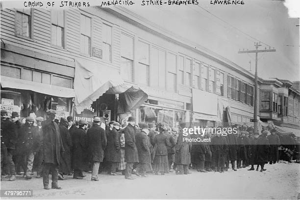 During the Bread and Roses Strike strikers threaten strikebreakers Lawrence Massachusetts January 1912