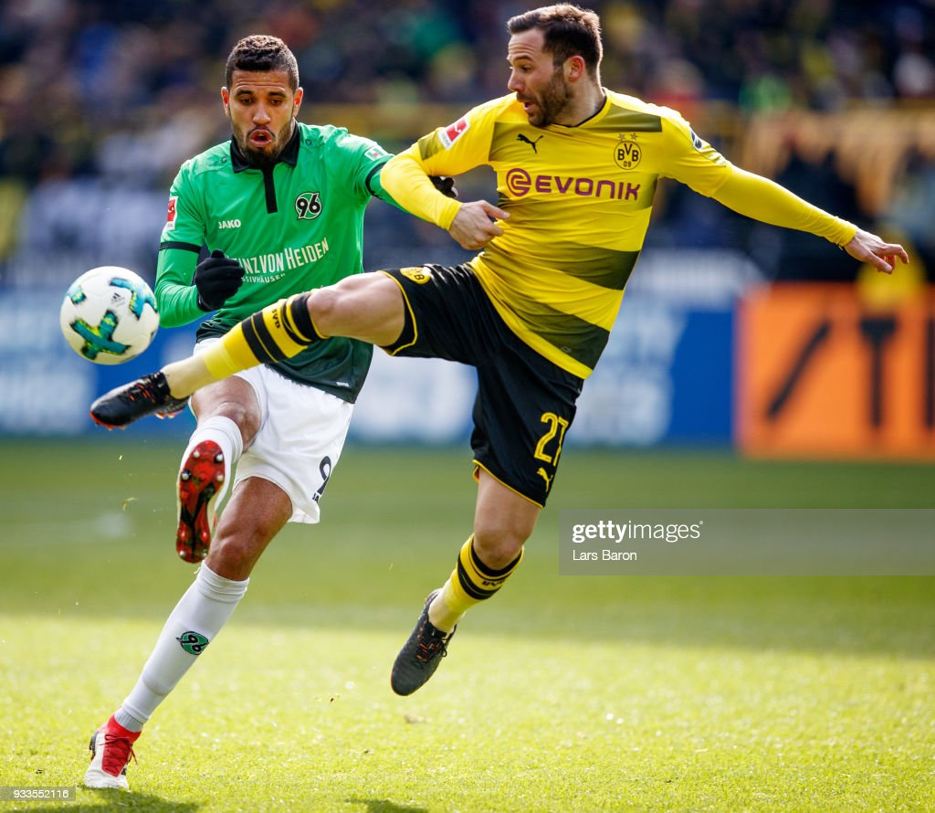 during the Bundesliga match between Jonathas of Hannover is challenged by Gonzalo Castro of Dortmund Borussia Dortmund and Hannover 96 at Signal Iduna Park on March 18, 2018 in Dortmund, Germany.