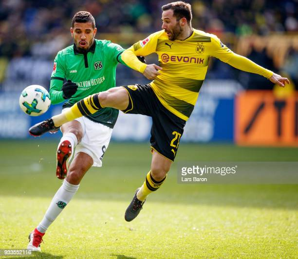 during the Bundesliga match between Jonathas of Hannover is challenged by Gonzalo Castro of Dortmund Borussia Dortmund and Hannover 96 at Signal...