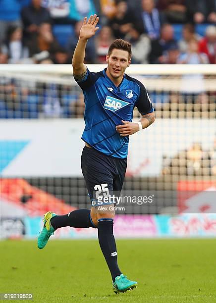 Niklas Suele of Hoffenheim celebrates his team's first goalSINSHEIM GERMANY OCTOBER 30 during the Bundesliga match between TSG 1899 Hoffenheim and...
