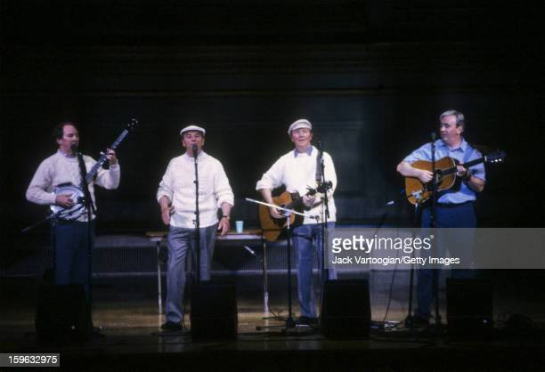 During the Carnegie Hall Folk Festival Irish musicians the Clancy Brothers from left Bobby Clancy Paddy Clancy and Liam Clancy and Robbie O'Connell...