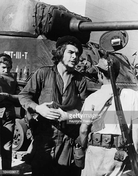During the Castroist revolution in Cuba Major Ernesto GUEVARA here next to a tank participating in the SantaClara battle against the troops of...