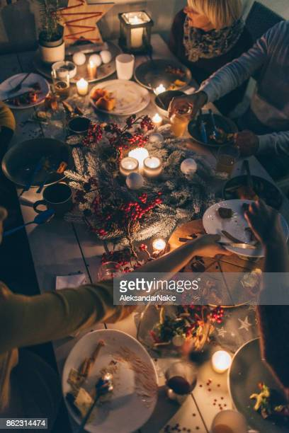 during the celebration.. - christmas dinner stock photos and pictures