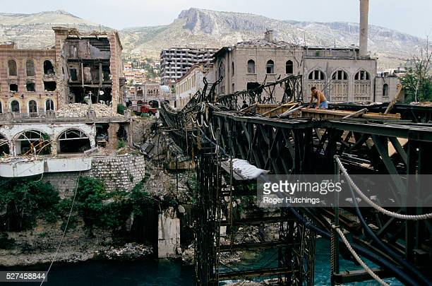 During the civil war in the former Yugoslavia 19911995 the city of Mostar which was part Croat part Moslem was divided in twoThe moslem east...