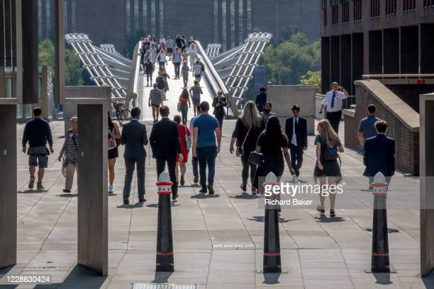 During the Coronavirus pandemic, Londoners and visitors to the capital walk through Peter's Hill, the end of which is the Millennium Bridge seen...