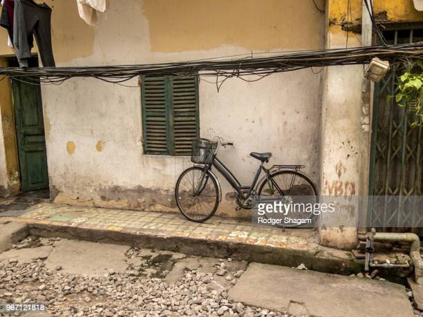during the day, the bicycle is left outside, at night it's moved into the front room - stoep stock pictures, royalty-free photos & images