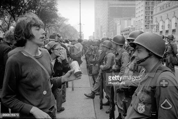 During the Democratic National Convention a line of demontrators face a line of National Guardsmen across the street from the Hilton Hotel at Grant...