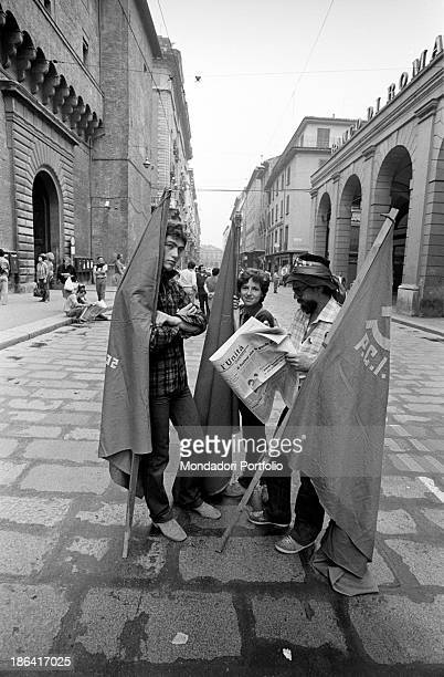 During the demonstration organized by the Federation of Italian Communist Youth on the occasion of the Festa de l'Unità three young men stopping in...