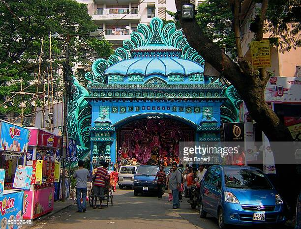 CONTENT] During the Durga Puja temporary temple structures called pandals like this one are built from bamboo and canvass at street crossings where...