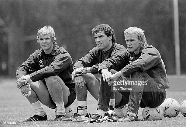 During the England Football Summer Tour, England goalkeepers Chris Woods , Peter Shilton and Gary Bailey relax at a training session held at the...