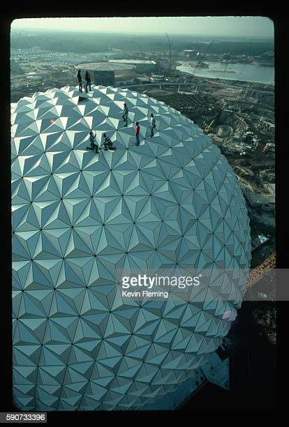 During the final stages of construction workers bolt aluminum panels onto the frame of Spaceship Earth the 180foothigh geosphere that is the...