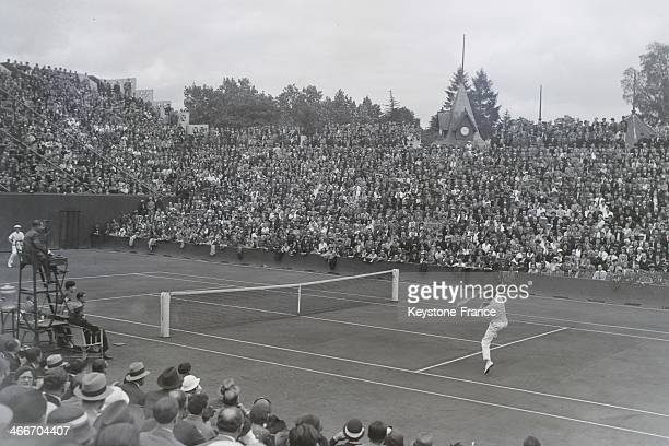 During the first day of the Davis Cup final French tennis champion Jean BOROTRA background against American player Ellsworth Vines at Roland Garros...