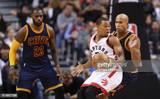 TORONTO ON OCTOBER 28 During the first half Toronto Raptors guard Kyle Lowry tries to back up to the hoop and take Cleveland Cavaliers forward...