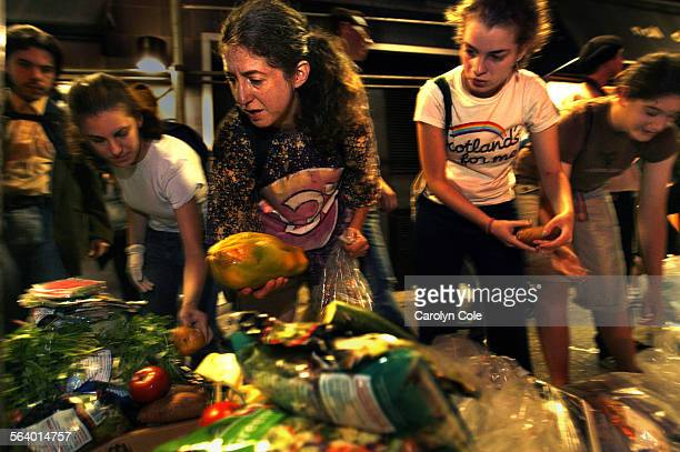 YORK – During the Freegan Trash tour Janet Kalish left collects vegetables like eggplant for an upcoming party with the help of Rachel Zelinsky who...