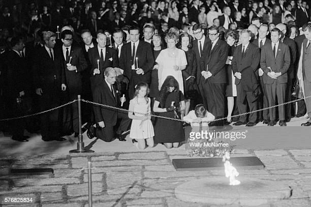 During the funeral for Robert Kennedy Jacqueline Kennedy widow of John F Kennedy visits her husband's gravesite along with their children Caroline...