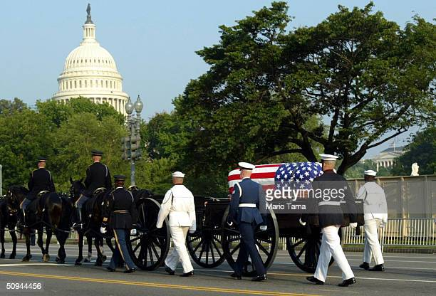 During the funeral procession, the casket of former President Ronald Reagan is taken in horse-drawn carriage towards the U.S. Capitol June 9, 2004 in...