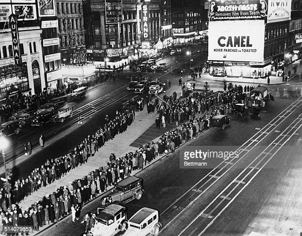 During the Great Depression, unemployed, hungry people wait in line at Times Square for rations.