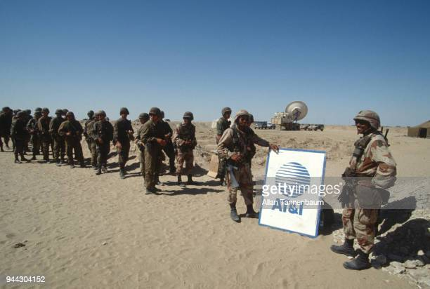 During the Gulf War a group of American soldiers as they stand in line next to an ATT sign Iraq 1991 The American telecommunications company ATT...