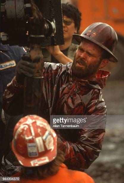 During the Gulf War oil workers work to cap a well in a blowout Kuwait 1991