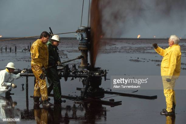 During the Gulf War oil workers work to cap a well in a blowout Kuwait 1991 Other wells burn in the background