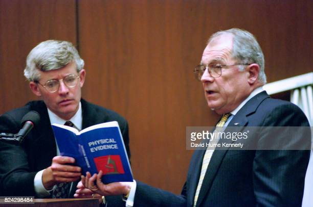 During the hair and fiber crossexamination defense attorney F Lee Bailey shows a physical evidence book to FBI agent Douglas Deedrick at the OJ...