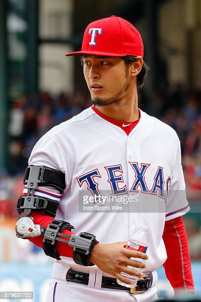 During the home opener between the Houston Astros and the Texas Rangers, Rangers Pitcher Yu Darvish wears an arm brace after under going Tommy John...