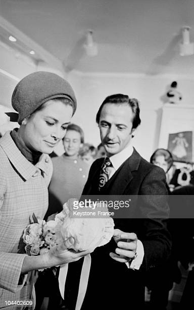 During the inauguration of a BABY DIOR boutique sponsored by Grace of MONACO on avenue Montaigne in Paris the Princess examined a children's bonnet...