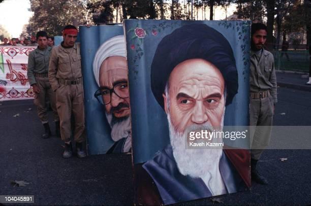 During the IranIraq War Iranian Basiji hold portraits of the religious leaders Ayatollah Khomeini and Ayatollah Montazeri at a rally at Azadi stadium...