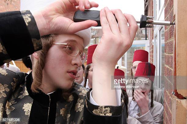 During the Jewish festival of Purim a group of Orthodox Jewish boys from the Viznitz Yeshiva in fancy dress visit local businessmen to collect money...