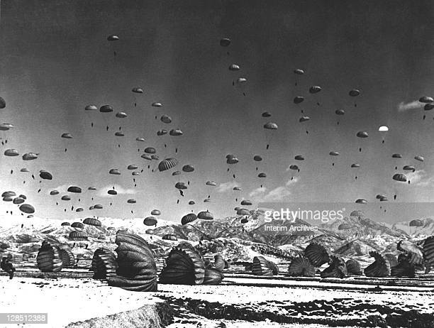 During the Korean War, soldiers and equipment are parachuted in an operation by United Nations airborne units, 1951.