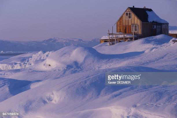 During the long winter which rages in the region of Ammassalik its inhabitants spend most of their time in their overheated Danishstyle homes...