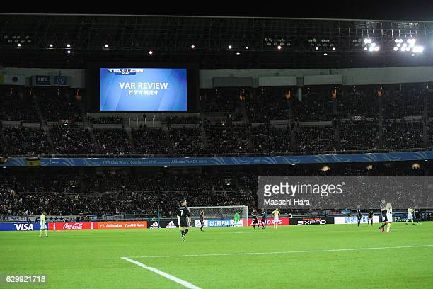 During the match referee refers a decision to the video assistant referee during the FIFA Club World Cup Semi Final between Club America and Real...