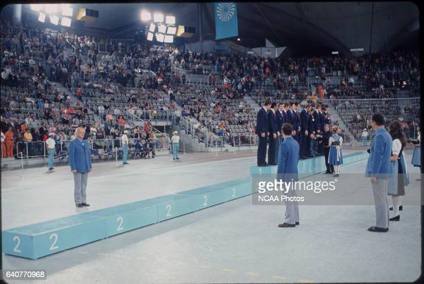 During the medal ceremony for the basketball competition, the second place podium remained empty as the US basketball team protested the decision to...