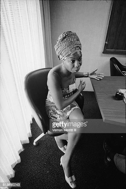 During the NARA convention American musician Nina Simone sits at a table in the Regency Hyatt Hotel Atlanta Georgia August 9 through 13 1967