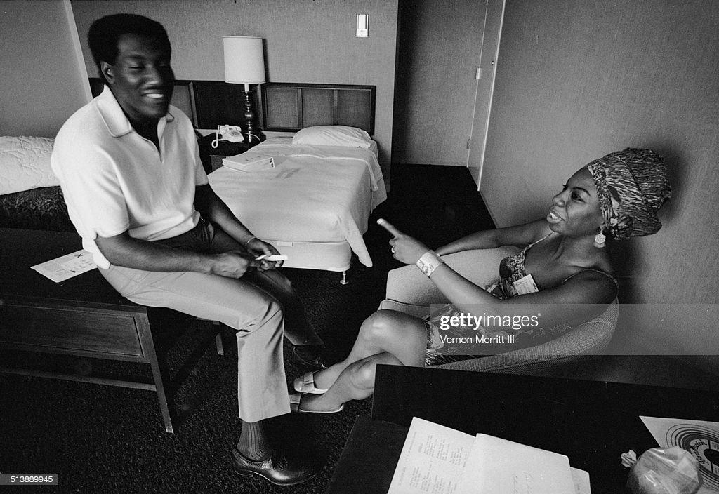 During the NARA (National Association of Radio Announcers) convention, musicians Otis Redding (1941 - 1967) and Nina Simone (born Eunice Waymon, 1933 - 2003) share a laugh in a room at the Regency Hyatt Hotel, Atlanta, Georgia, August 9 through 13, 1967.