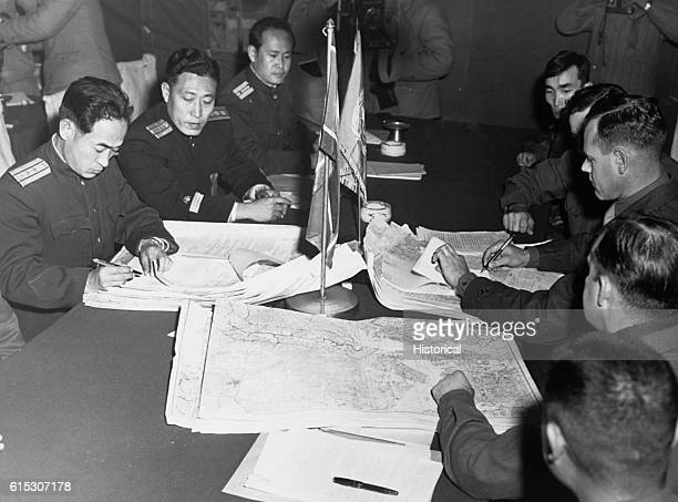 During the Panmunjom cease fire talks on October 11 Col James Murray Jr USMC and Col Chang Chun San of the North Korean Communist Army initial maps...