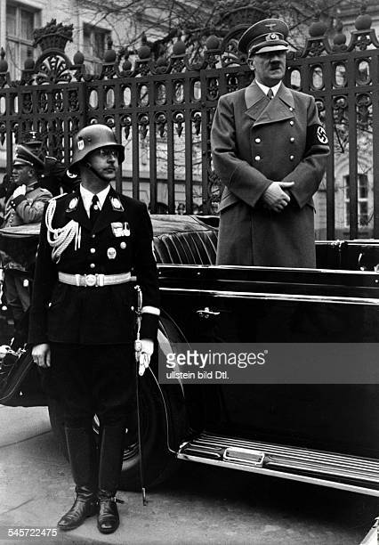 During the parade of the SS in Wilhelmstrasse: Adolf Hitler and Heinrich Himmler in front of the old chancellery -