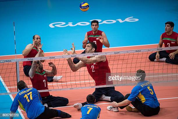TOPSHOT Iran's Morteza Mehrzadselakjani sets the ball during the Sitting Volleyball Men's Preliminaries Pool B Match between Ukraine and the Islamic...