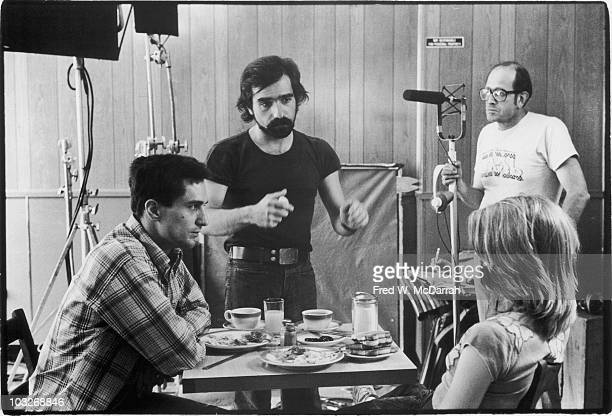 During the production of the film 'Taxi Driver' American film director Martin Scorsese speaks to teenaged actress Jodie Foster and actor Robert De...