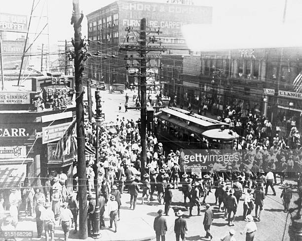 During the racial East St Louis Riot of 1917 a mob beats an African American man in front of a street car while the militia charged with restoring...