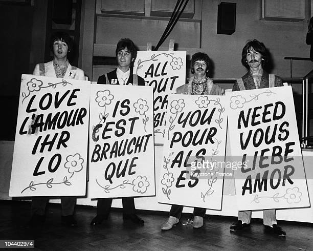 During the recording of the program LIVE in Abbey Road EMI studios the four members of the BEATLES showing posters on which was written LOVE IS ALL...