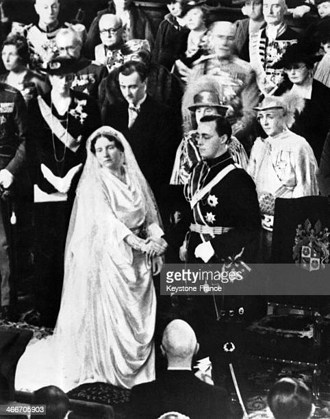 During the religious ceremony in Saint Jacob Church Princess Juliana and Prince Bernhard newlyweds hold hands on January 7 1937 in The Hague...
