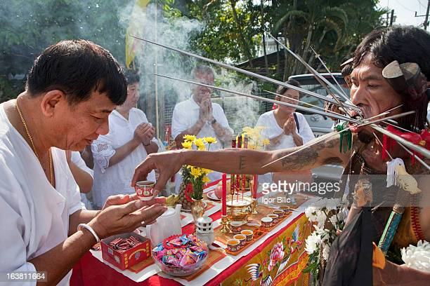 CONTENT] During the religious procession and their walk of faith little stalls are set up on the sides of the roads in Phuket town Little gifts are...
